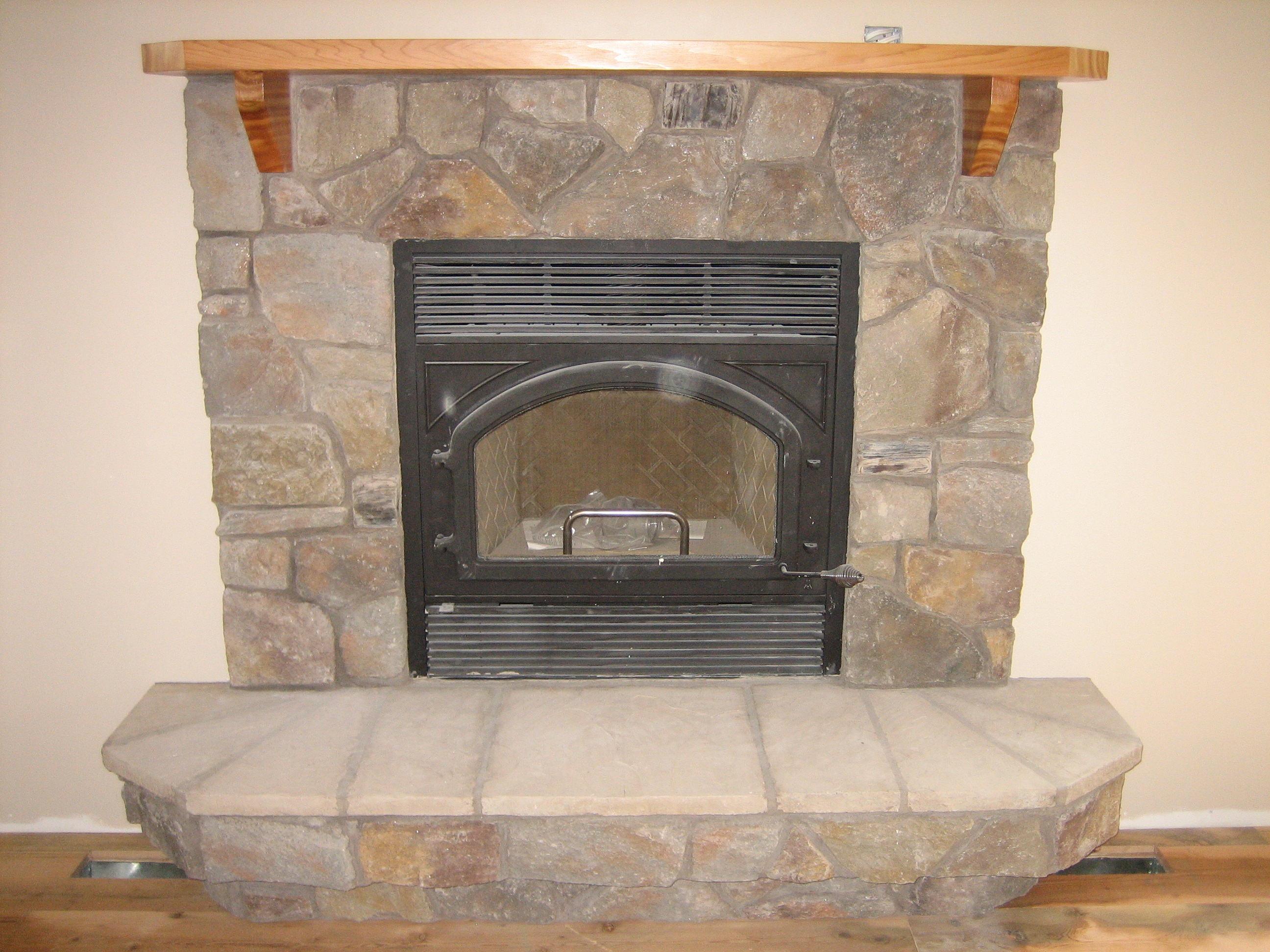 rustic corner hearth design